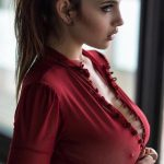 sexy-woman-wearing-red-show-cleavages